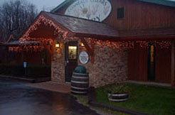Conneaut Cellars Winery shown in the evening during extended holiday hours in December.