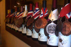 A row of winning wines is shown with their awards from 2015 and 2016.
