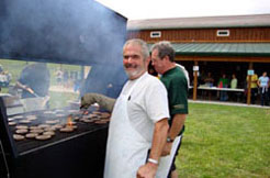 Employees grilling hamburgers at the Conneaut Cellars Winery Annual Harvest Picnic in September.