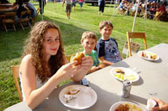 Kids and families are enjoying food at the Conneaut Cellars Winery June picnic event.